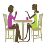 2 women chatting at table