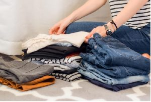 Lady folding clothes