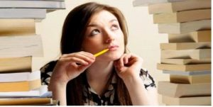 Lady thinking with pen in mouth