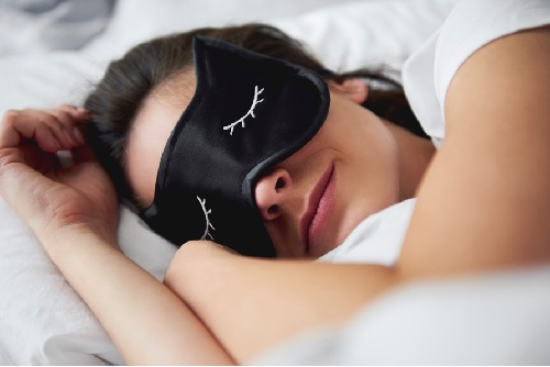 Lady sleeping with eye patches